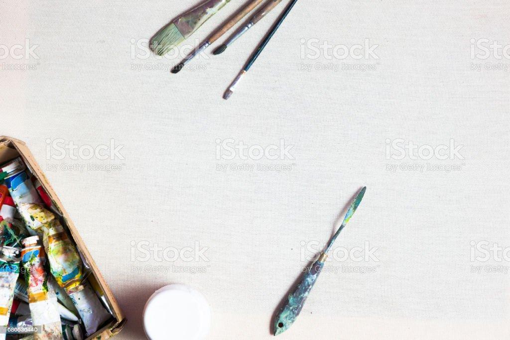 Painter equipment on canvas royaltyfri bildbanksbilder