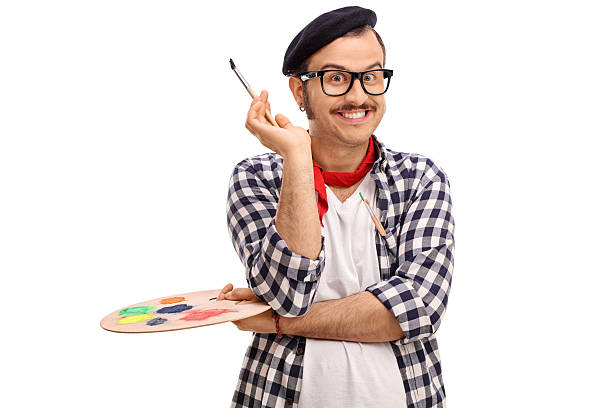 Painter holding a paintbrush and a color palette stock photo
