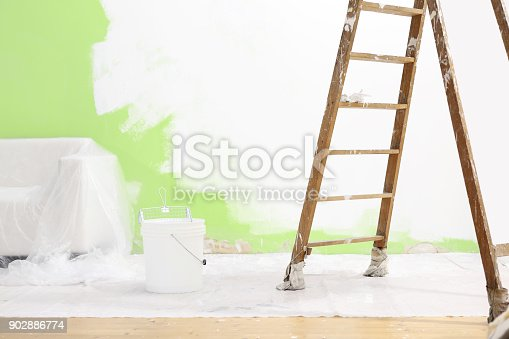 istock painter house concept, wooden ladder, bucket, and white and green color wall 902886774
