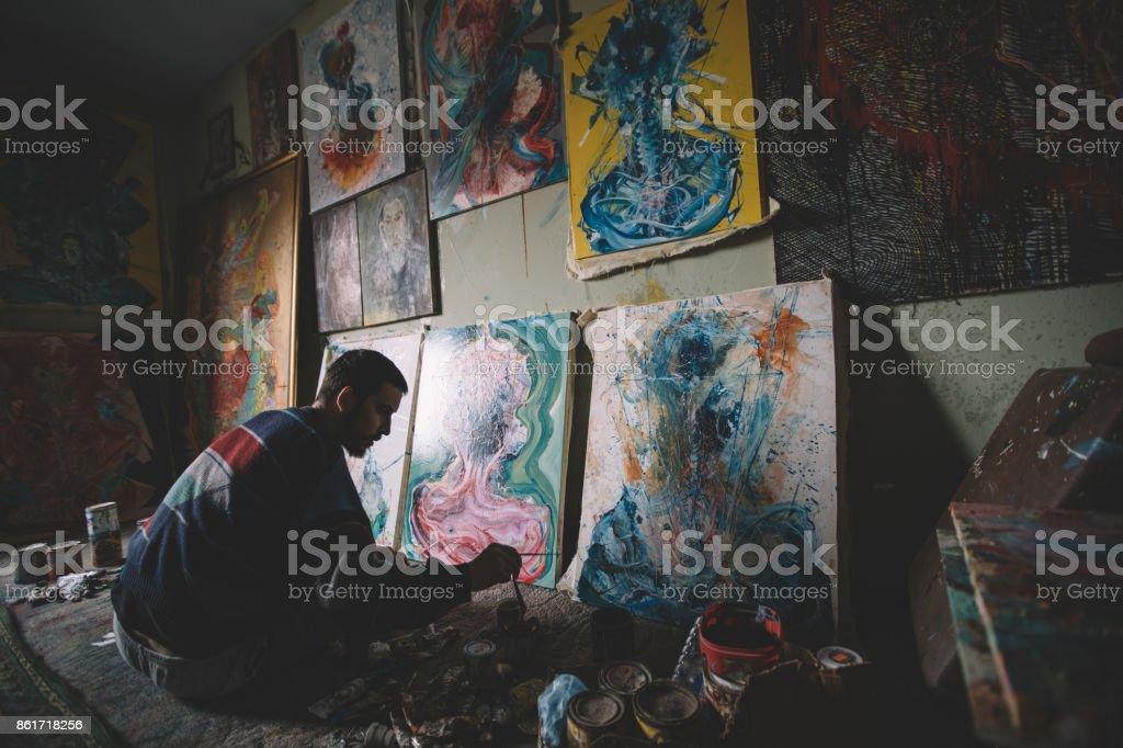 Painter in studio stock photo