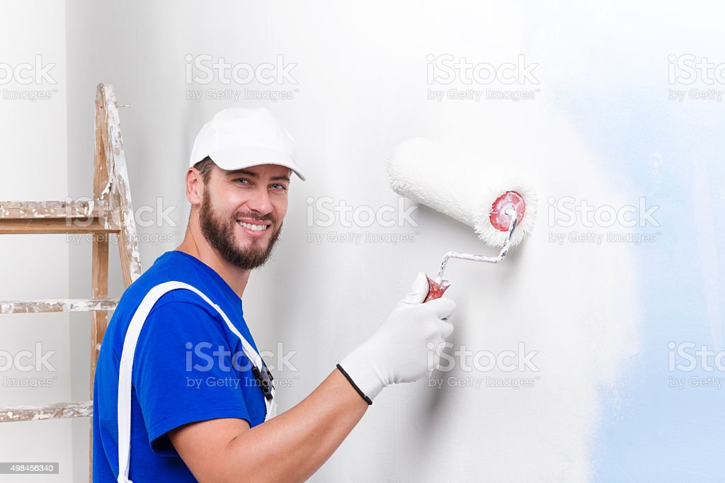 painter in white dungarees, blue t-shirt stock photo