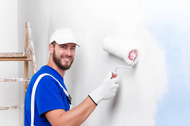 painter in white dungarees, blue t-shirt - painter stock photos and pictures