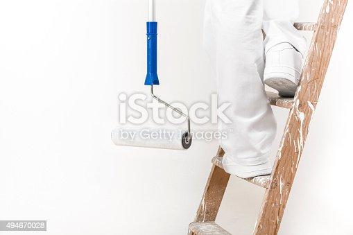 istock painter man at work climbing a ladder with pain 494670028
