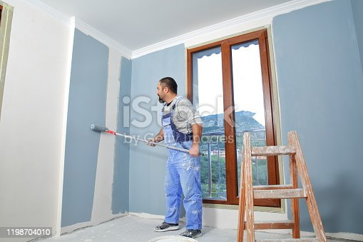 589454570 istock photo Painter man at work 1198704010