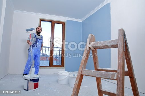 589454570 istock photo Painter man at work 1199741127