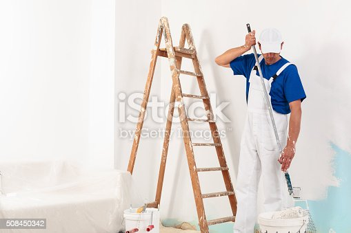 589454570 istock photo Painter man at work 508450342