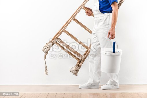 istock Painter man at work with vintage ladder and bucket. 494669784