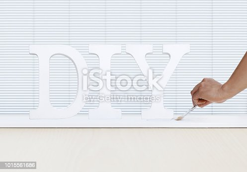 istock painter man hand with paint brush painting text diy on white board, house service concept, blank banner template with copy space 1015561686