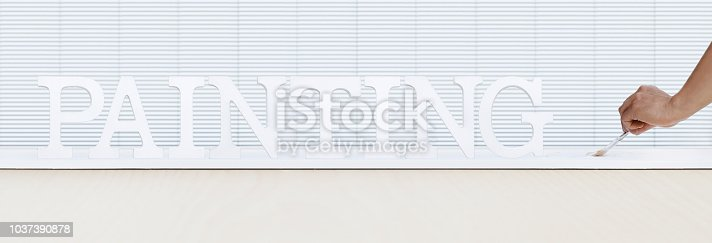 istock painter man hand with paint brush painting text on white board, house service concept, blank banner template with copy space 1037390878