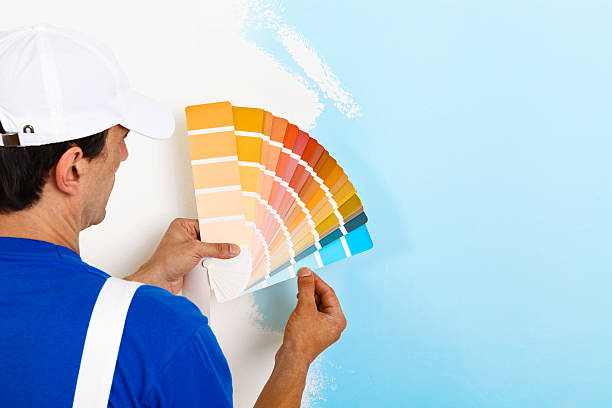 painter man looking a color palette - painter stock photos and pictures
