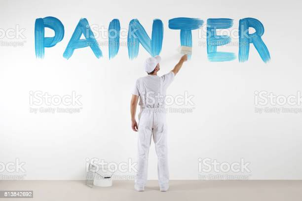 Painter man with paint brush drawing a blue painter text isolated on picture id813842692?b=1&k=6&m=813842692&s=612x612&h=axkgccw2stspwwj3xhdekbh4oselcrns7n3okpqsllo=