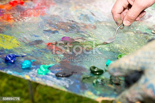 504223972 istock photo Painter Mixing Paint By Palette Knife 538994776