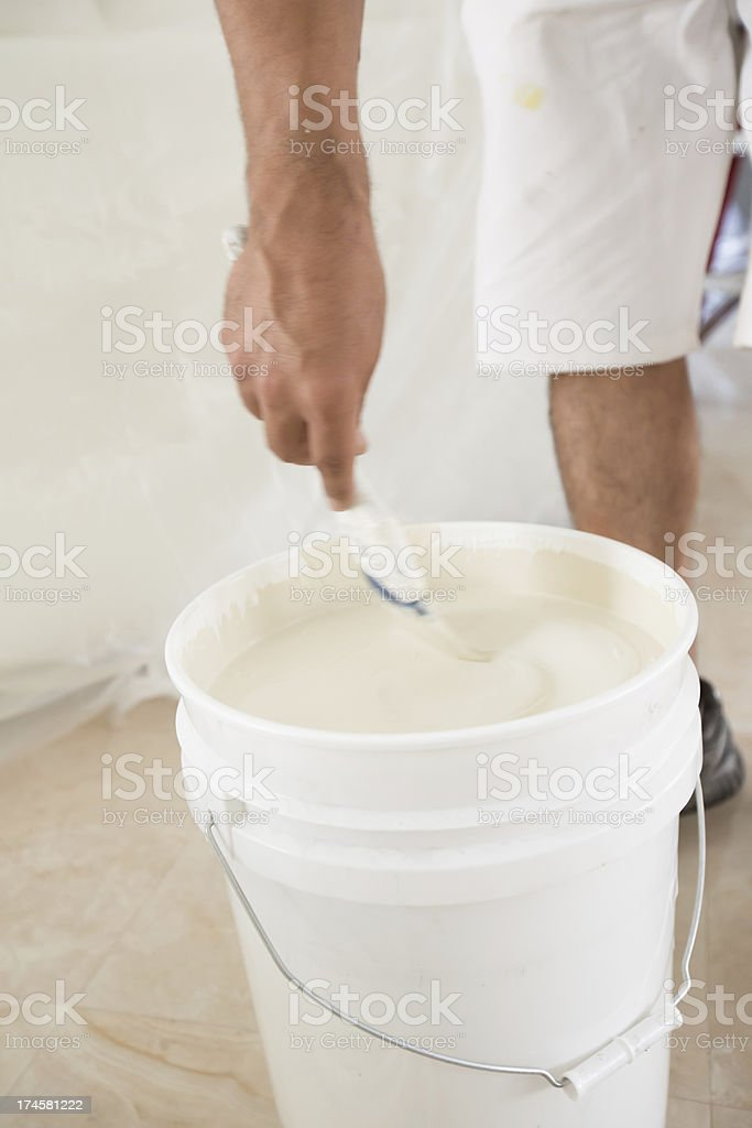 Painter mixing paint royalty-free stock photo