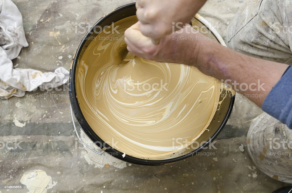 Painter mixing paint stock photo