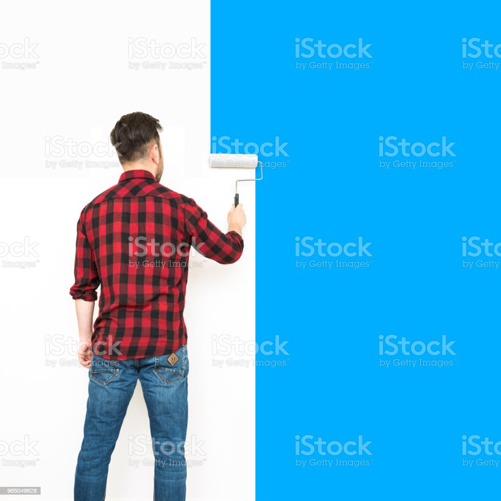Painter painting with paint roller royalty-free stock photo