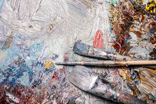 Painter palette and dirty brushes stock photo