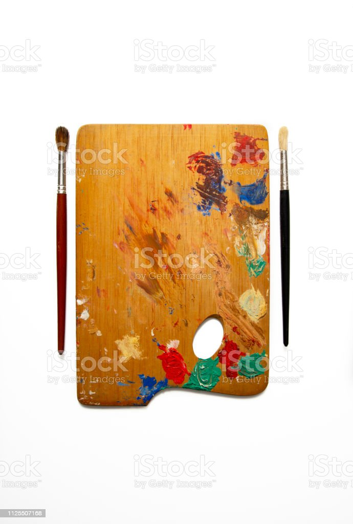 Painter palette with brushes stock photo