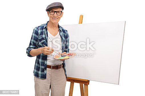 istock Painter posing next to a canvas 603276682