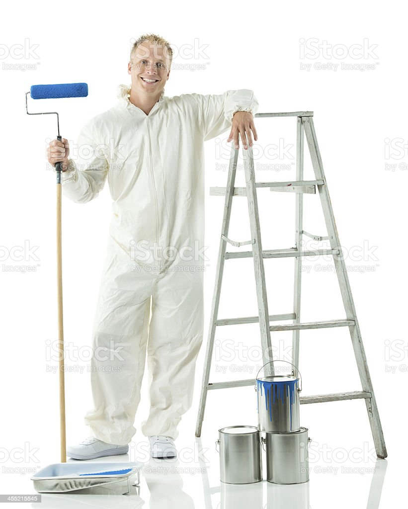Painter posing while holding a paint roller stock photo