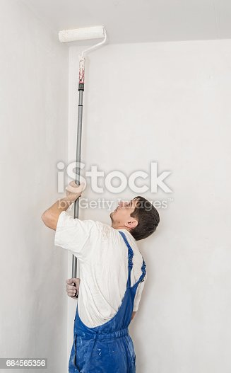 Painter Use Paint Roller Stock Photo & More Pictures of