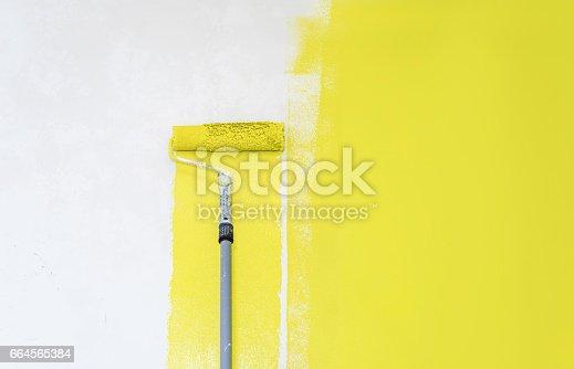 istock Painter use paint roller 664565384