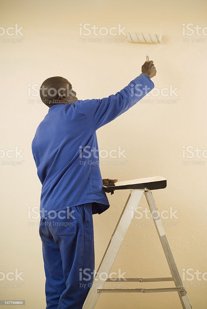 Painter using a Paint Roller stock photo