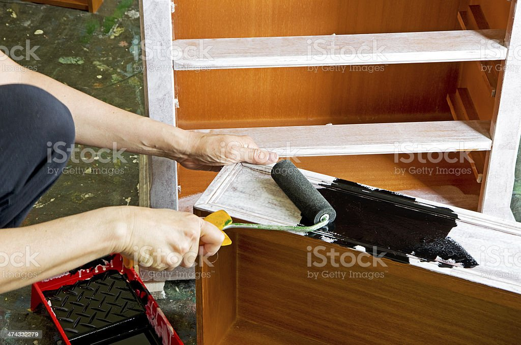 painter with paint roller stock photo
