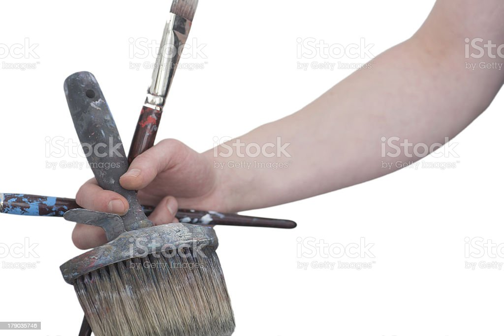 painter with paintbrushes in hand stock photo