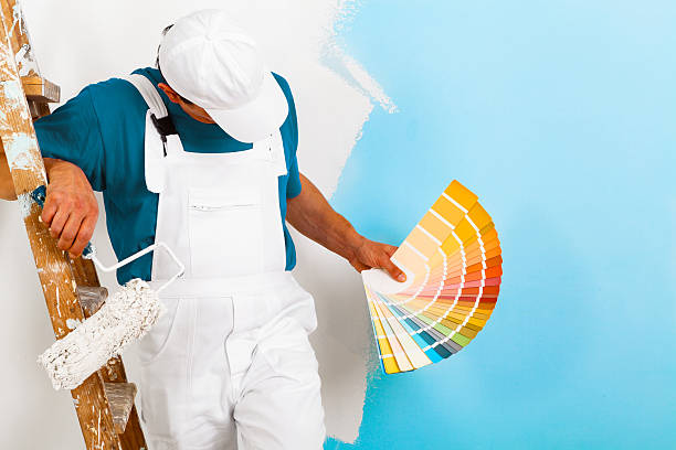 painter  with paintroller showing a color palette - painter stock photos and pictures