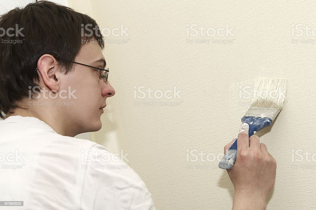 Painter worker decorator with brush royalty-free stock photo