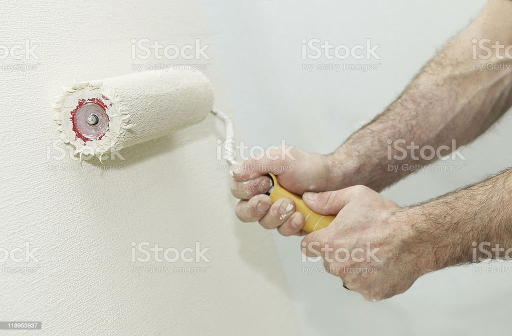 Painter worker hand with roller royalty-free stock photo