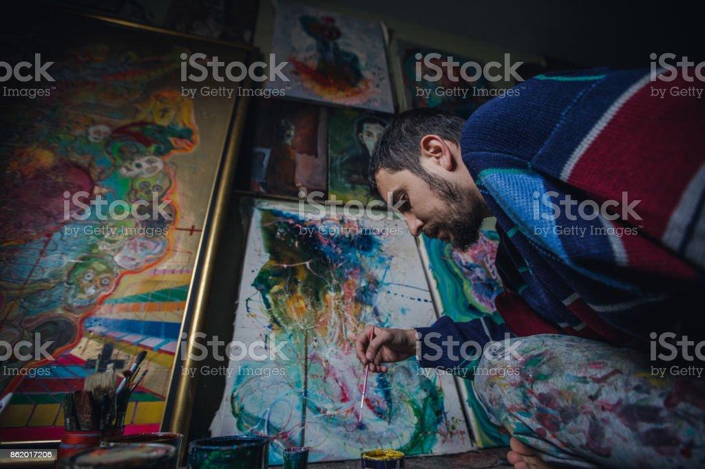 Painter working in studio stock photo