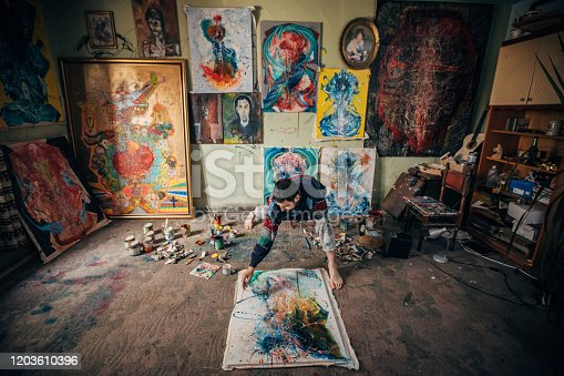 865169666 istock photo Painter working on painting in studio 1203610396