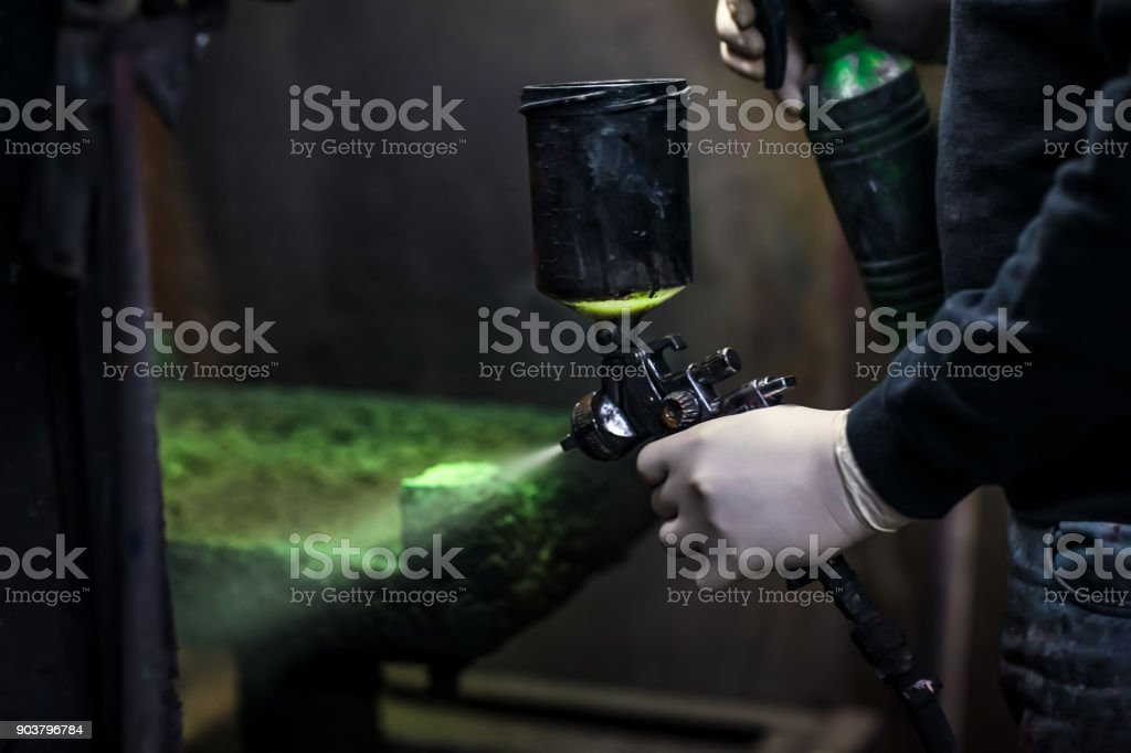 Painter working with airbrush stock photo