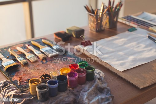 824254912 istock photo Painter workplace. Palette with brushstrokes and paintbrushes. Colorful gouache, crayons sets 695137804