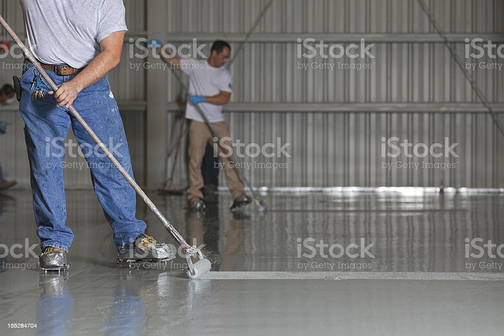 Painters Apply Epoxy Paint to an Airport Hanger royalty-free stock photo