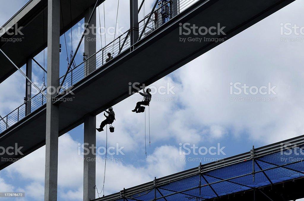 painters are working on bridge stock photo
