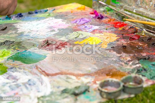 504223972istockphoto Painter's colorful bright palette with fresh paint 538997312