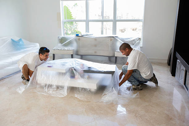 Painters covering furniture stock photo