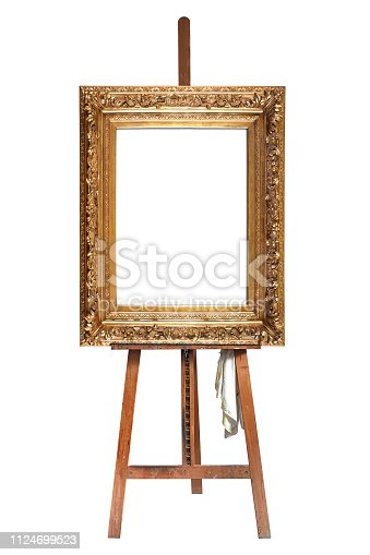 Painter's easel and empty antique golden frame isolated with clipping path