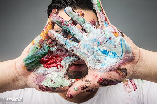 istock A painter's hand is covered with paintDrawing paint 1167789767