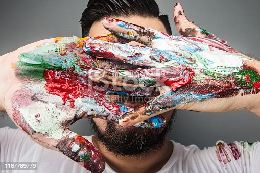 istock A painter's hand is covered with paintDrawing paint 1167789779