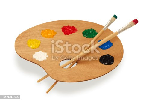 Painter's palette with brushes isolated on white background