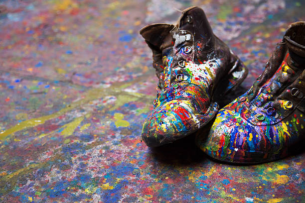 Painter's painted boots stock photo