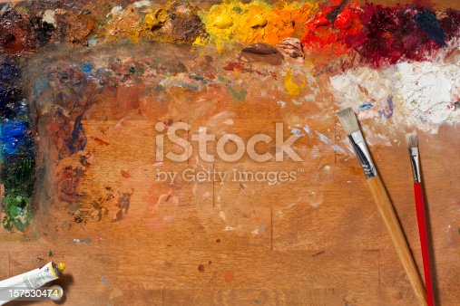 Painters Palette with paint and brushes. Big Full Frame image with a lot of Copy Space area, Horizontal.