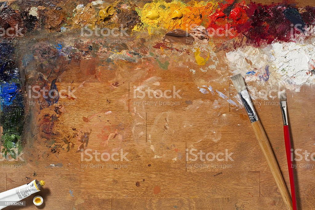 Painters Palette and Brushes. Full Frame, Horizontal. stock photo