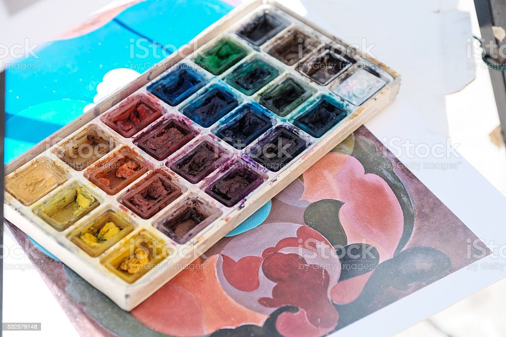 painter's palette full of colors on a sketch stock photo