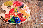 Close up of painter's palette on wooden table.