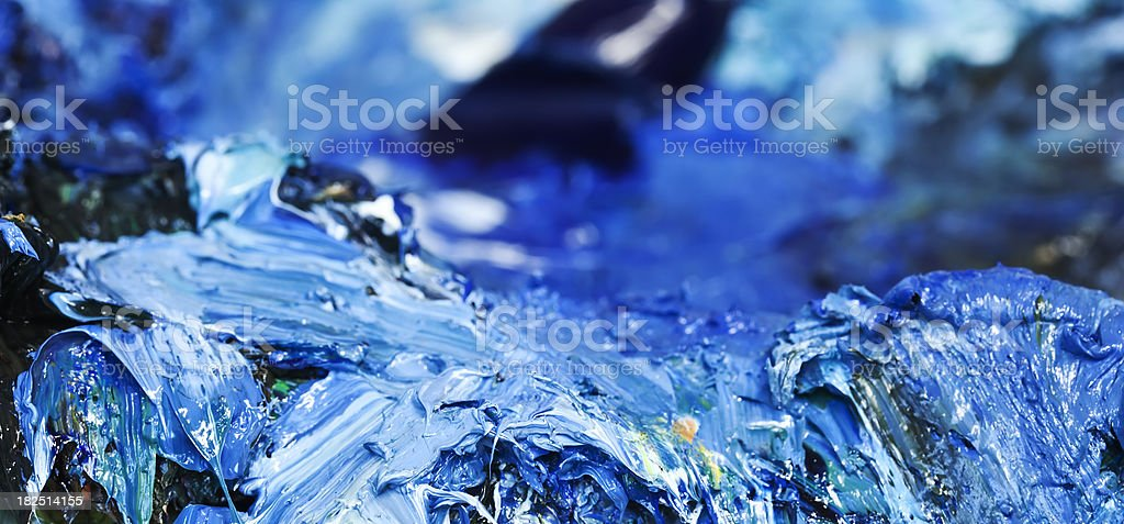 Painter's  palette  with blue  colors. royalty-free stock photo