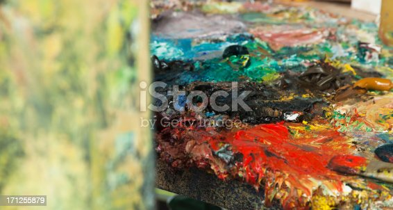 504223972istockphoto Painter's pallet and brushes. 171255879